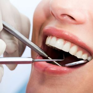 Reconstructive Dentistry: 3 Signs You Need A Tooth Extraction